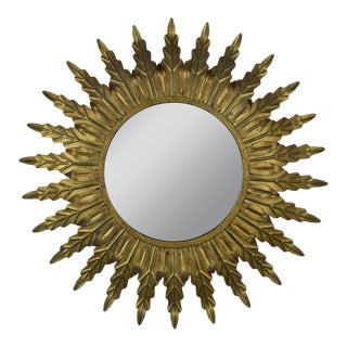 Gilt Metal Sunburst Mirror With Radiating Leaves and Traces of Green For Sale
