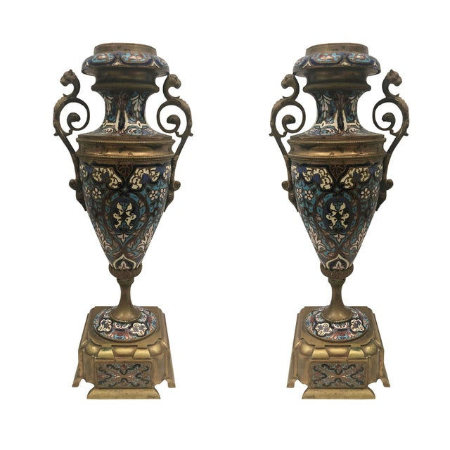 A lovely pair of 19th century French Renaissance Revival Champleve vases in bronze with enamel decoration.