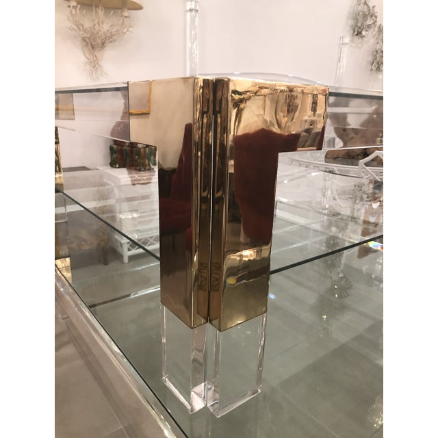 Vintage Hollywood Regency chunky lucite & brass, two tier glass (new glass) coffee cocktail table. Lucite and brass have...