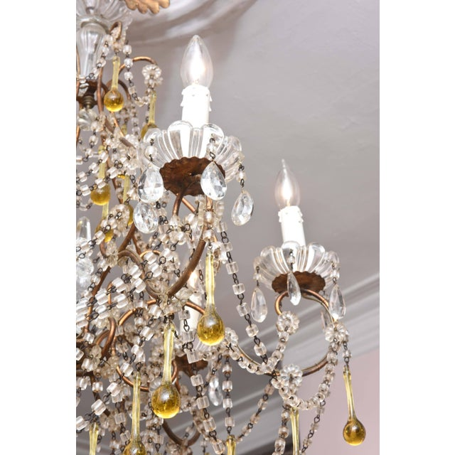 A charming blown glass bead swag chandelier with amber colored drops. Retaining its all original glass pieces and we do...