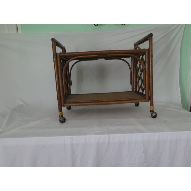 This stylish unique 1960's 2 shelf bar cart has 3 elements in it's construction; cane wicker and rush. and it has a...