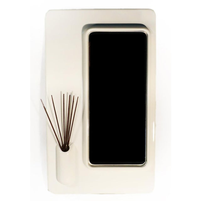 This unique white plastic mirror could be an ideal vanity, wall, or table top mirror. It has a perfect slot for a tooth...