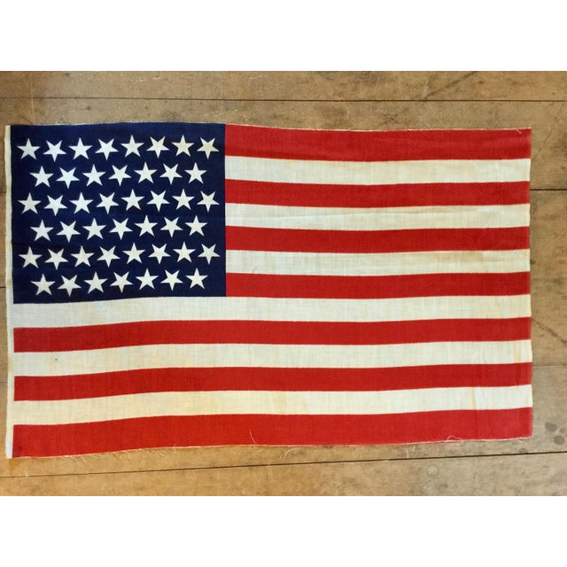 """Printed cotton parade flag from the period 1896-1908 with """"tumbling stars"""" making a graphic and dynamic pattern. Bright..."""