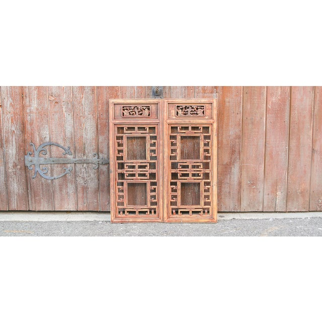 A charming set of two carved window panels, of tenon and mortise joint construction and all hand carved and adorned with...