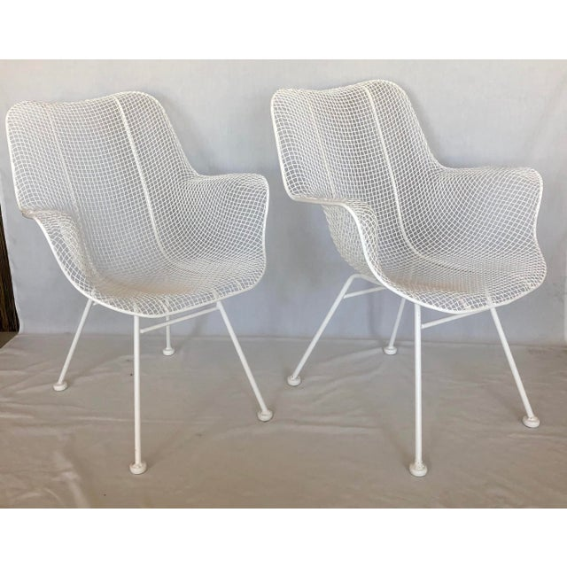 Classic pair of white armchairs designed by Russell Woodard-- from the Sculptura series. The chairs have been...