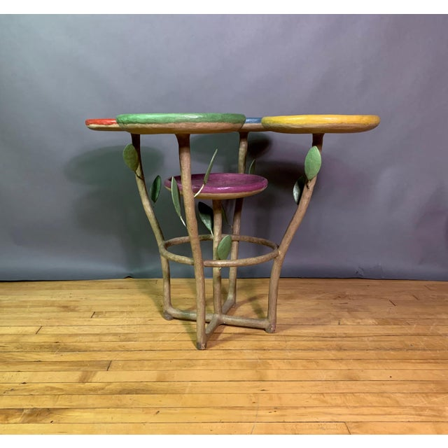 This is a one-of-a-kind artist (French) created piece - a five-plate (petal) plant stand in a solid resin. Four holders on...