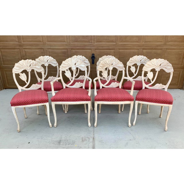 Two arm chairs and 6 side chairs are included in this set. The backs of these chairs are beautifully carved like flowers....