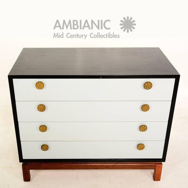For your consideration a four drawer dresser by Cal Mode. Ebonized walnut frame with light grey color on pull out drawers....