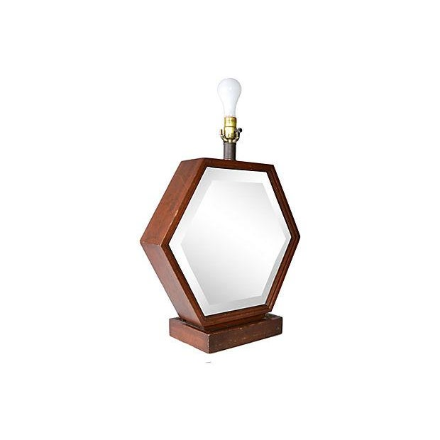 Mid-Century Modern hexagonal wood and mirror table lamp. In working condition; takes one 60W-max bulb. Harp and shade are...