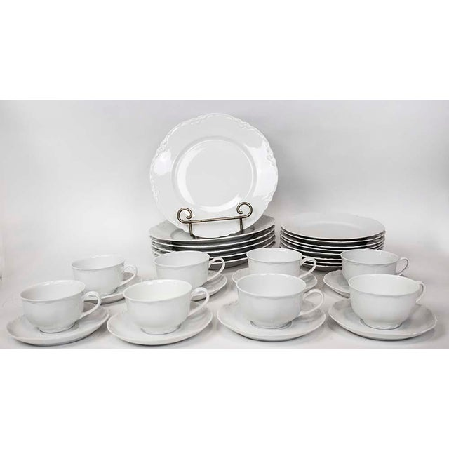 "Service for 8 Hutschenreuther Selb china in the simple & elegant Racine pattern. Includes 8 each: Cups 2 3/8"" h x 3 7/8 w..."