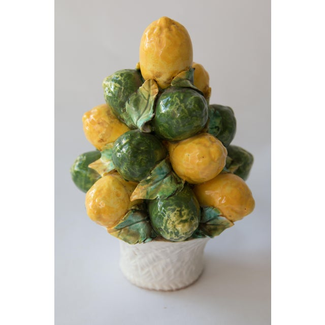 Charming small Mid Century Italian majolica lemon and lime topiary. Brighten up your kitchen or dining room with this...