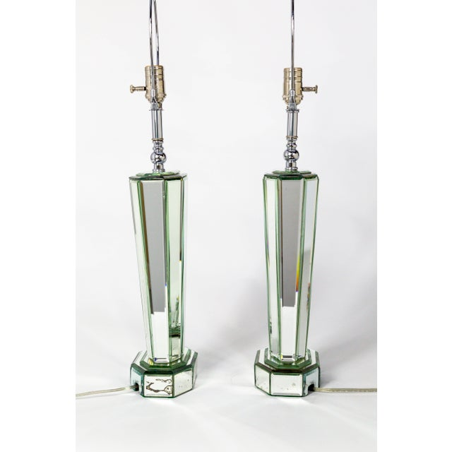 A pair of striking, modern, beveled mirror table lamps that create beautiful light reflections. A late 1970's, streamlined...