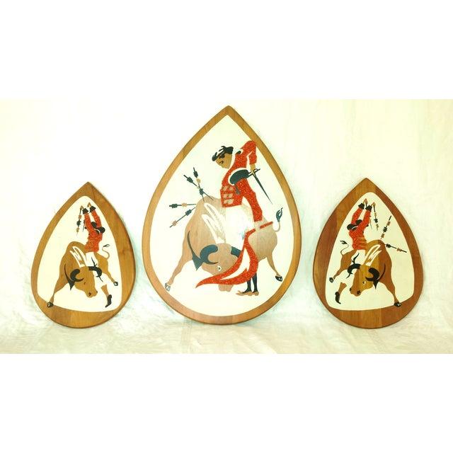 Mid Century Modern Popcorn Art or Gravel Art 3 Matadors. Black, orange and white bold graphic art on beautiful teak wood...