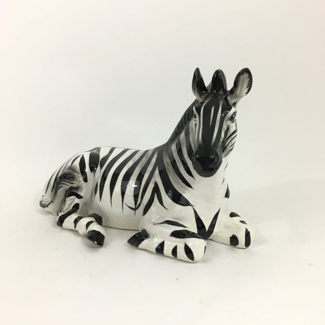 Vintage ceramic laying zebra figurine / sculpture in resting position. Hand painted with beautiful attention to detail....