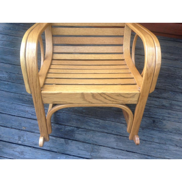 Here we have a 1991 Bent Oak Slat Back Rocking Chair Artist Made by R. Benna. This rocker is all handmade. To bend oak is...