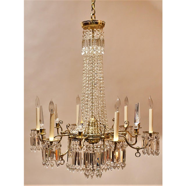 #9359XB American, Circa:1850. This gas-burning fixture was converted to electricity in the early 20th century. The brass...