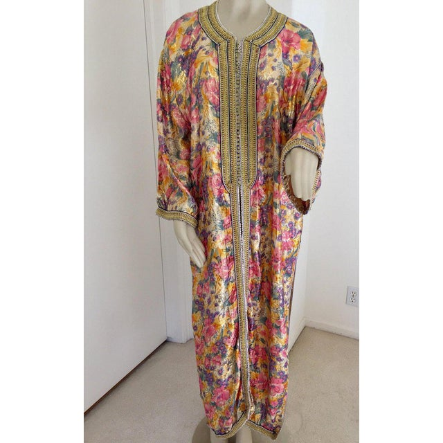 Elegant Moroccan caftan metallic silk floral brocade, circa 1970s. This light summery caftan is crafted in Morocco and...