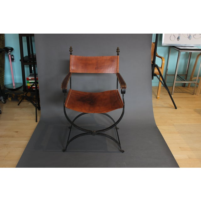Savonarola style black iron chair with leather featuring a beautiful natural patina from many years of use. Was used for...