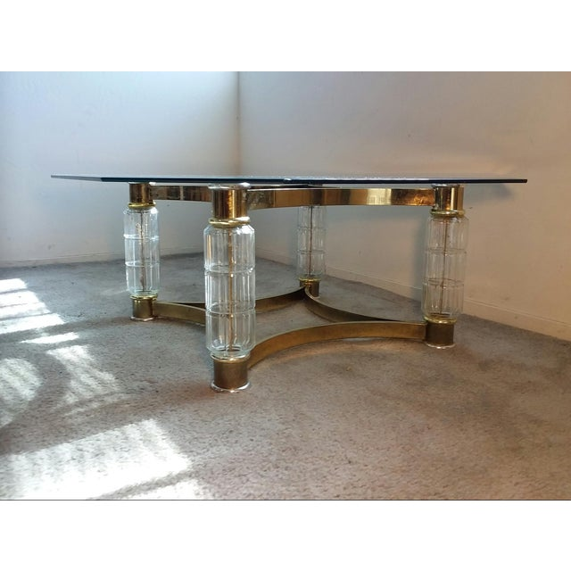 This dazzling Art Nouveau Coffee Table features an octagonal glass top supported by four faceted glass column legs with...
