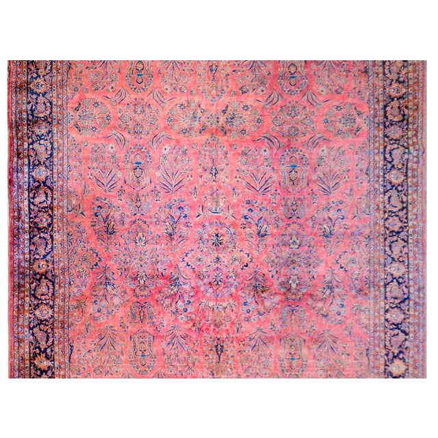 A grand 1920s Persian Kashan rug with a fantastic finely rendered pattern containing myriad flowers woven in light and...