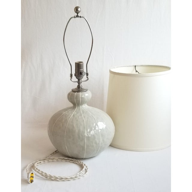 Unique, one of a kind artisan made gray Gourd lamp by kRI kRI Studio. Round and bulbous, this lamp in gray has a primitive...