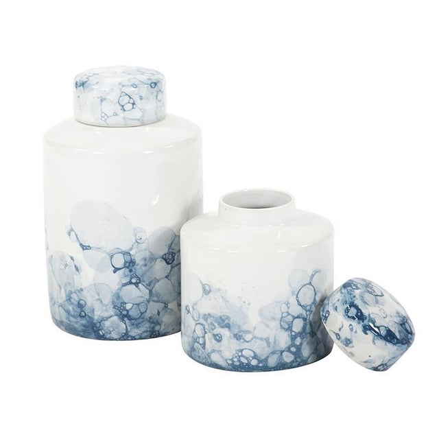 Blue and White Porcelain Tea Jar, Large This lidded tea jar starts with a white cylindrical ceramic base to which a...