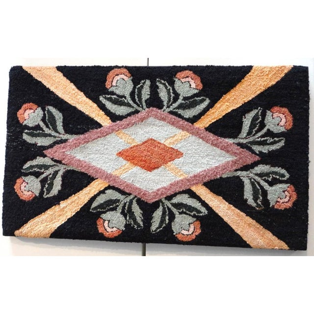 This mounted hand-hooked rug is from Lancaster County, Pennsylvania with the folky flowers and wonderful geometric...
