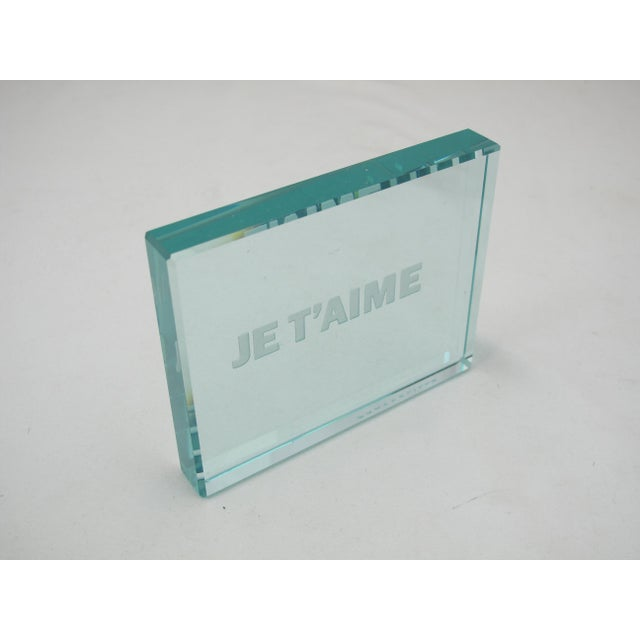 Reverse intaglio etched glass plaque with beveled corners reading JE T'AIME (I Love You). Signed on edge with artists last...
