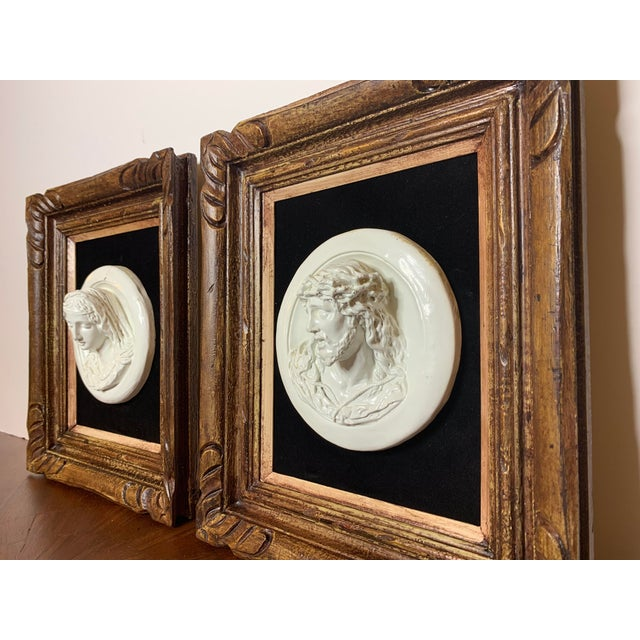Rare 19th-century Italian chalkware glazed high relief/ alto-relief busts statues of Mary and Jesus. Framed with dark...