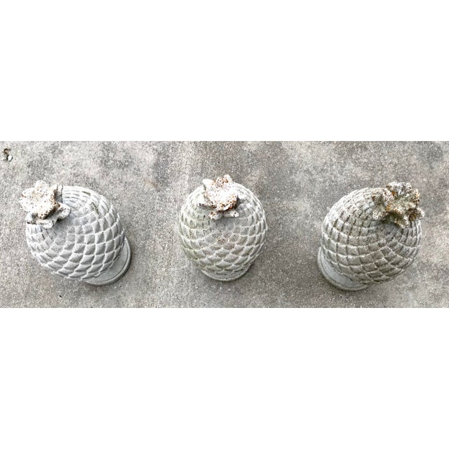 Three concrete artichoke finials from a mid century estate. Perfect for your garden or patio.