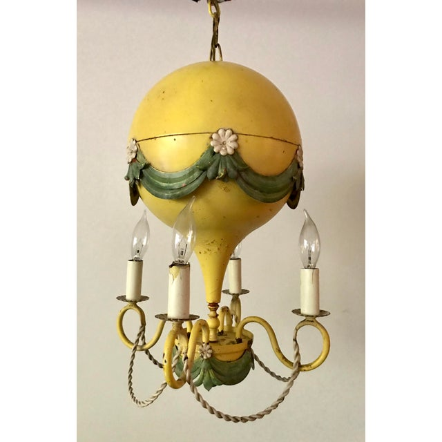 This is a stunning and whimsical piece from the early 20th century, made in France. It is a 4 light chandelier in the...