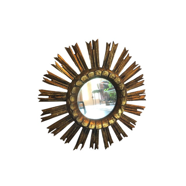 A vintage French giltwood sunburst mirror with an attractive design and ready for hanging.