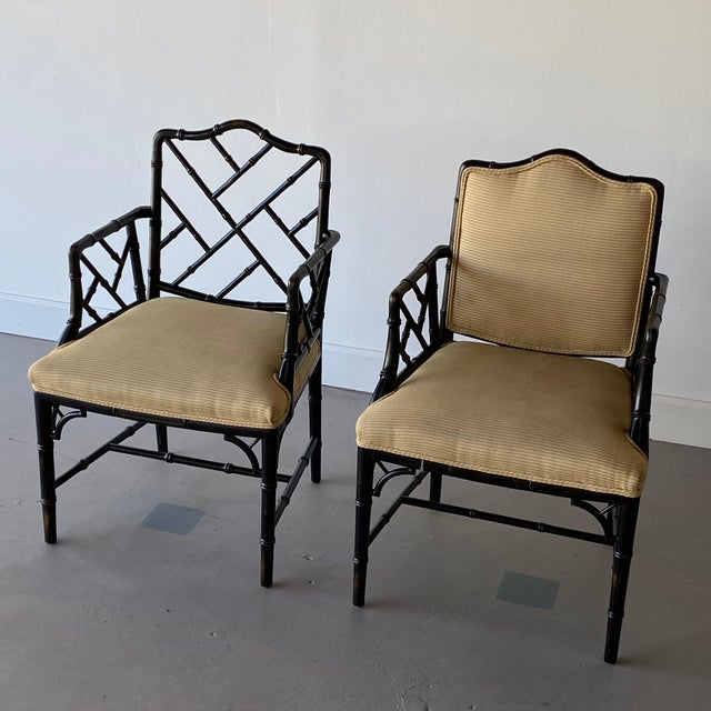 Pair of Faux Bamboo Regency Armchairs. One chair does not come with back cushion as seen in photos - made to make them...