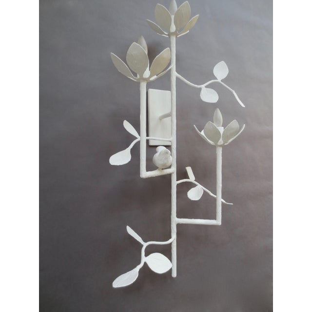 Three armed Garden Sconce with blossoms and birds. Can be sold as a pair to mirror each other or be identical. Electrical...