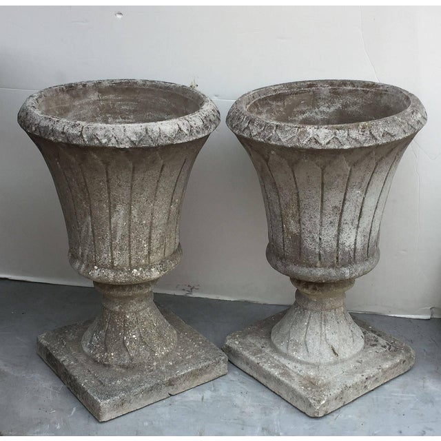 A fine pair of English garden urns or planters of composition stone in the classical style, each bowl featuring an...