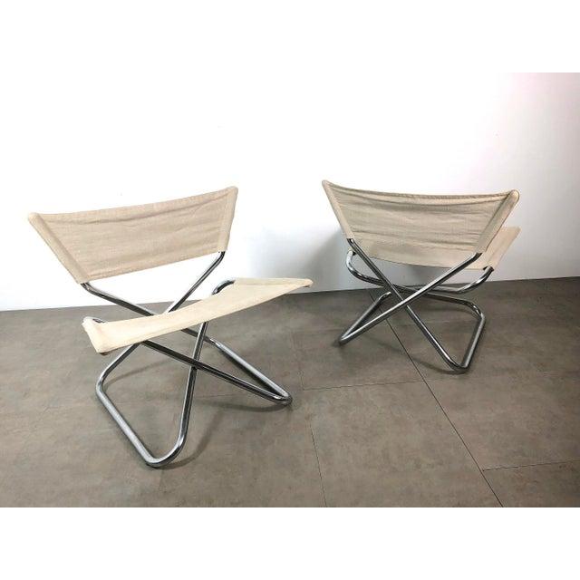 """Rare pair of """"Z-Down"""" chairs designed by Erik Magnussen for Torben Orskov Denmark 1960's. Folding tubular chromed steel..."""