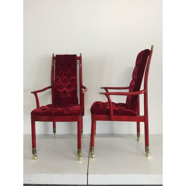 A very unusual pair of arm chairs in Red lacquer, with the original red tufted velvet fabric. These chairs are probably...