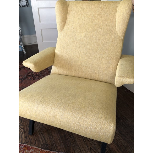 This single chair is a brand new and custom made chair by Pierre Paulin. Made in France of a lovely yellow fabric, it is...