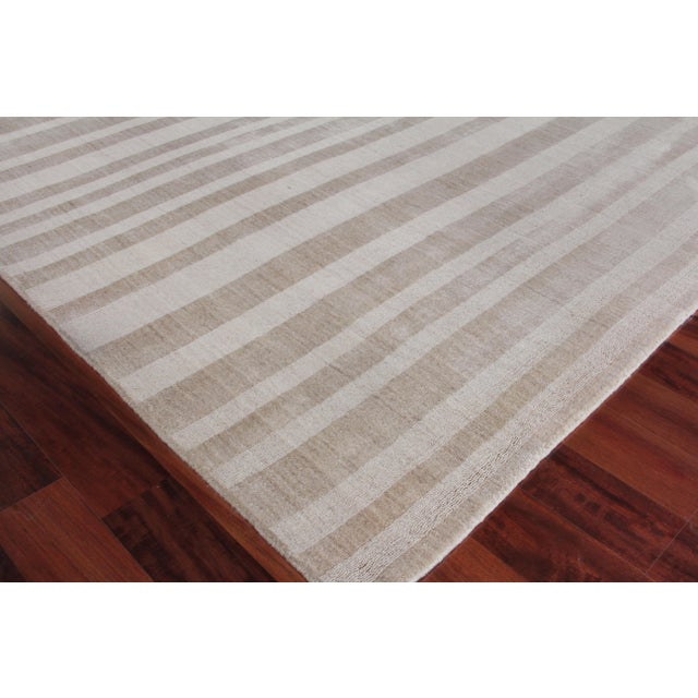 The linear tonal design of the Iscar rug is at once casual, chic and ultra sophisticated. Made of luxurious bamboo silk,...
