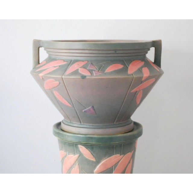Stunning vintage Roseville Pottery jardeniere and matching pedestal are part of the Futura line, dating to the 1920s....