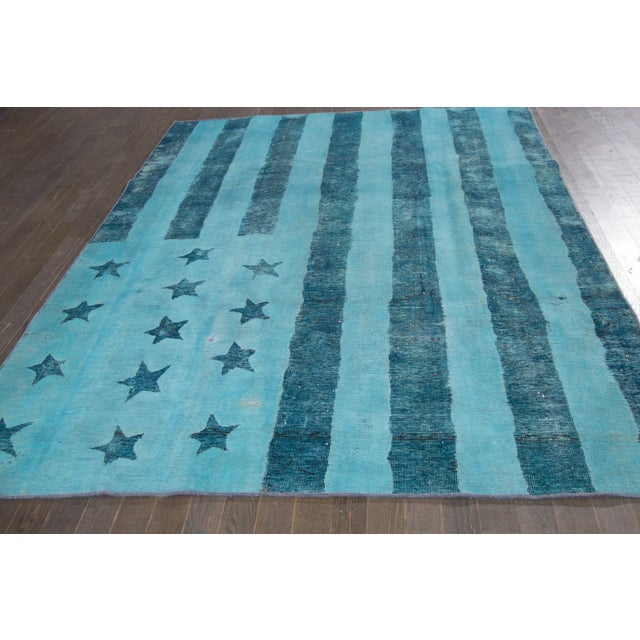Vintage, hand-knotted over-dyed rug with an American flag design in blue, This rug has fabulous, saturated color and is...