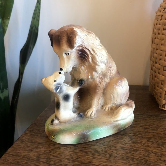 Sweet vintage painted ceramic figurine of a dog and puppy.