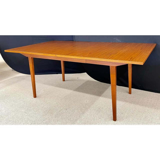 George Nelson & Associates dining table in teak wood for Herman Miller. This table is in pristine condition. Hide away...