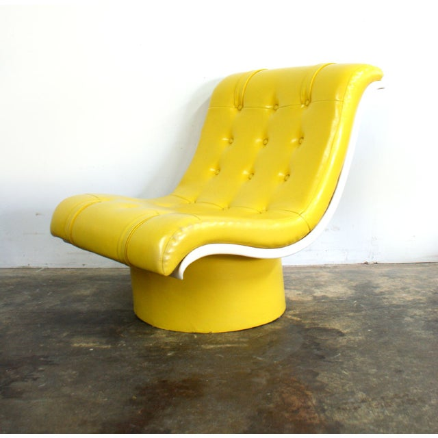1970s bright yellow naugahyde button tufted upholstered lounge chair with white plastic shell and naugahyde covered...