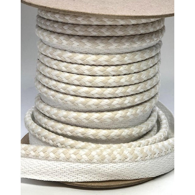 """One 10.9 yard spool of 1/4"""""""" braided cord with flange Cording colors are white and cream. Flange is 1/2"""""""" wide for sewing...."""