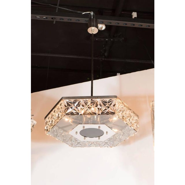 Mid-Century modernist faceted crystal chandelier in hexagonal form by Kinkeldey. Squares of hand-cut faceted crystals rest...