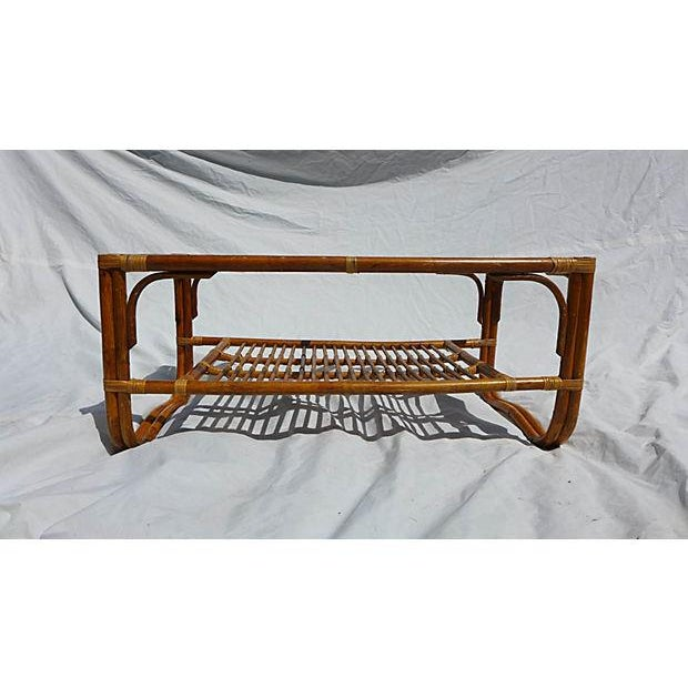 "70's vintage Albini style rattan coffee table with glass top. Some wear but sturdy in very good condition. 20"" L x 40"" W x..."