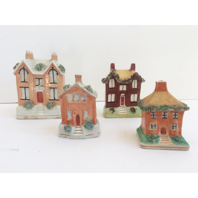 """Great little set of four Staffordshire miniature banks. The largest is 5.5""""high The smallest is 3.5""""."""
