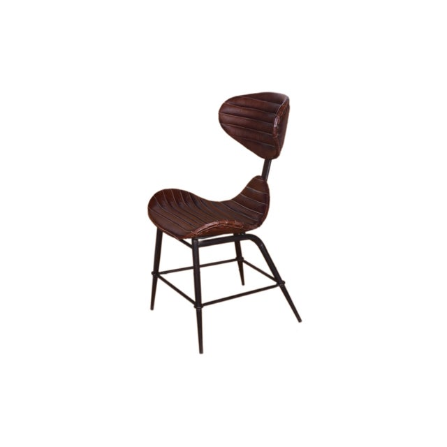 Bring a bit of understated style and modern appeal to any ensemble with this essential leather chair, the perfect pick to...