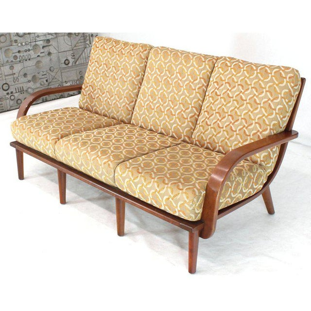 Mid-Century Modern solid bent maple three-seat sofa by Conant Ball. Outstanding craftsmanship woodworking makes it a very...